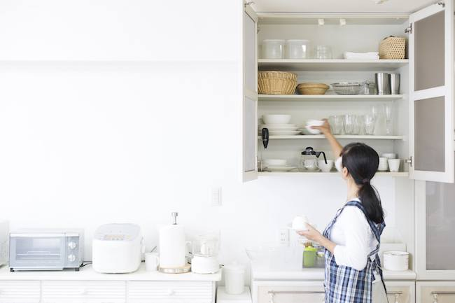 Woman organizing her kitchen