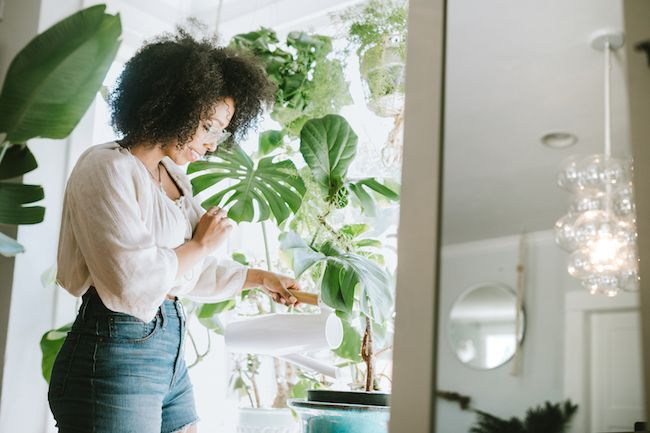 Woman watering her house plants