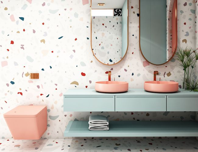 Double vanity bathroom sink with two mirrors and pink toilet.