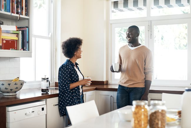 Couple discussing housing in the kitchen.