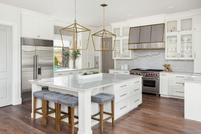 Luxury kitchen with a marble slab backsplash.