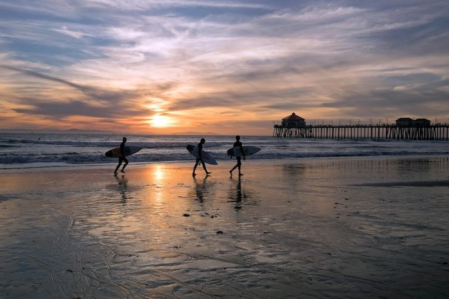 Most Expensive Cities In The US Orange County, California Huntington Beach Surfers