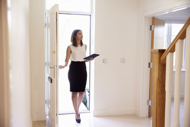 Female realtor about to walk through a home.