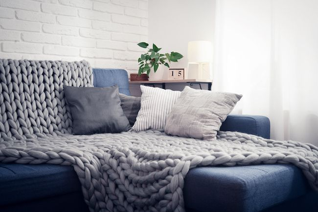 Cozy blue and grey couch.