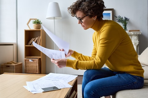 Woman sitting at coffee table doing taxes