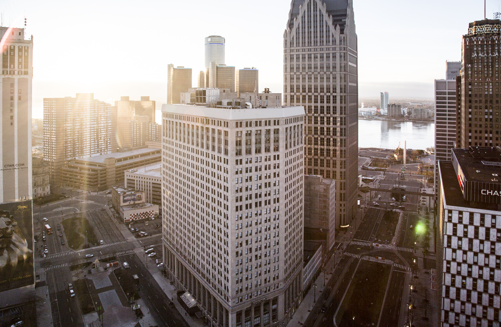 Downtown Detroit From The Rooftop Of 1001 Woodward During Sunrise. From Left To Right: The First National Building, Renaissance Center, One/Ally Detroit Center, Woodward Avenue, The Detroit River, Hart Plaza, One Woodward, The Guardian, And The Chase/Qube Building.