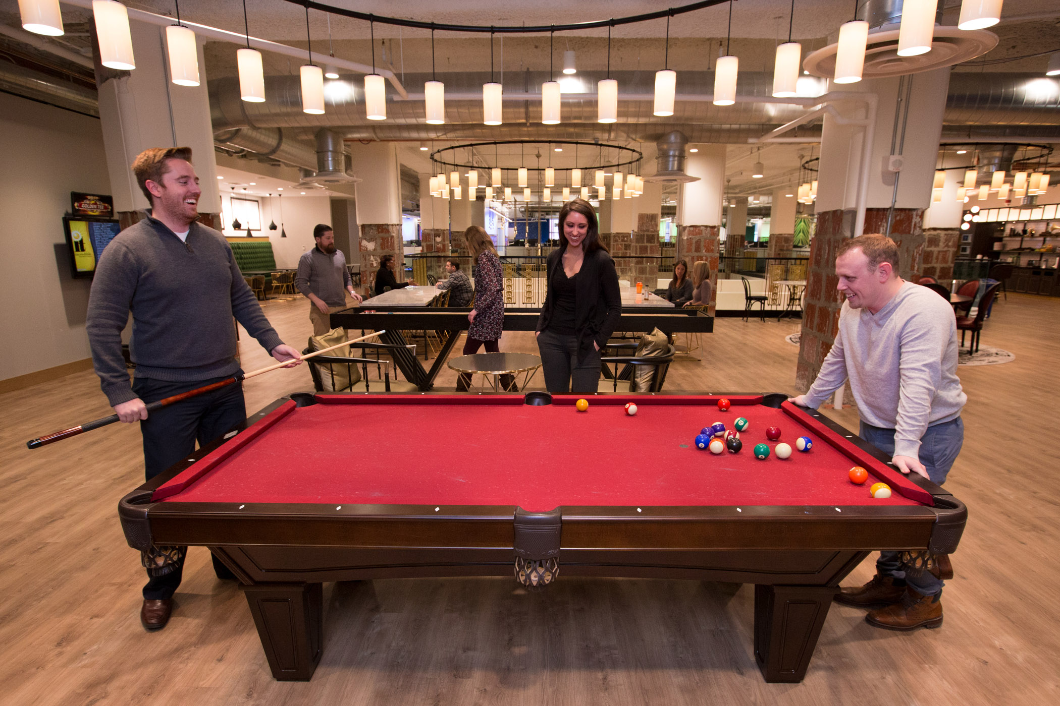 Culture Photo Of The Cleveland Office, 2017. Team Members Play Pool.